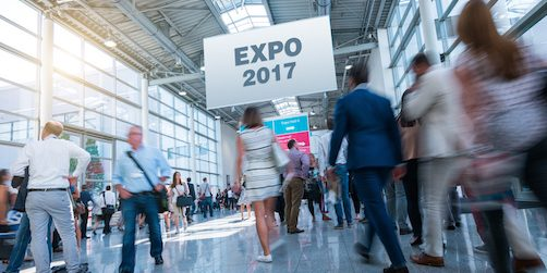 Blurred business people at a Expo 2017